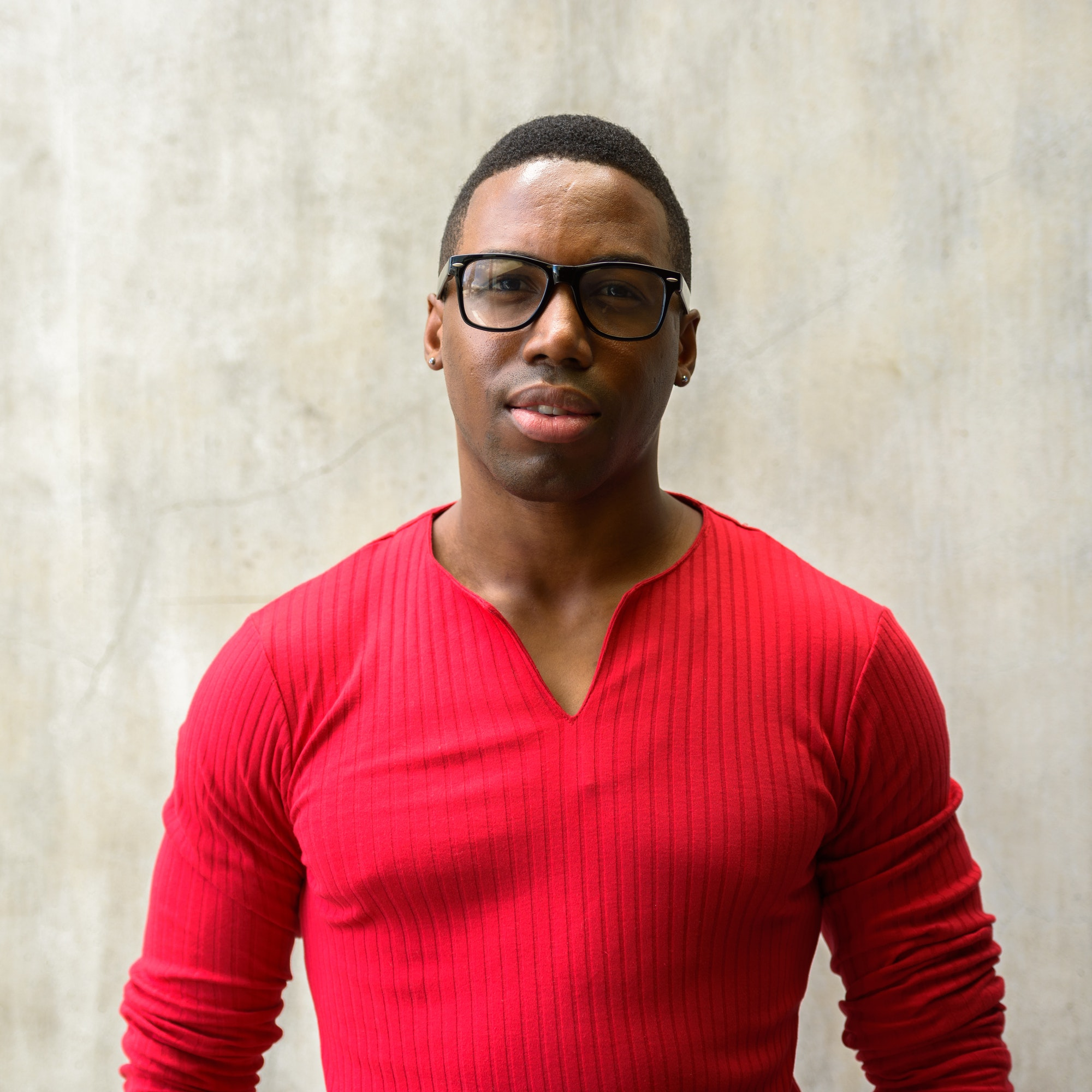 Portrait of young handsome African man with eyeglasses