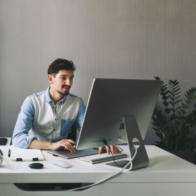 Young graphic designer working in office